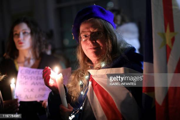AntiBrexit activists hold candles during a candlelight vigil organised by civil rights group New Europeans outside Europe House central London on...