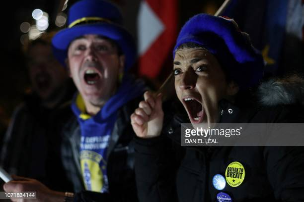AntiBrexit activists protest outside the Houses of Parliament in London on December 11 2018 British Prime Minister Theresa May began a humiliating...