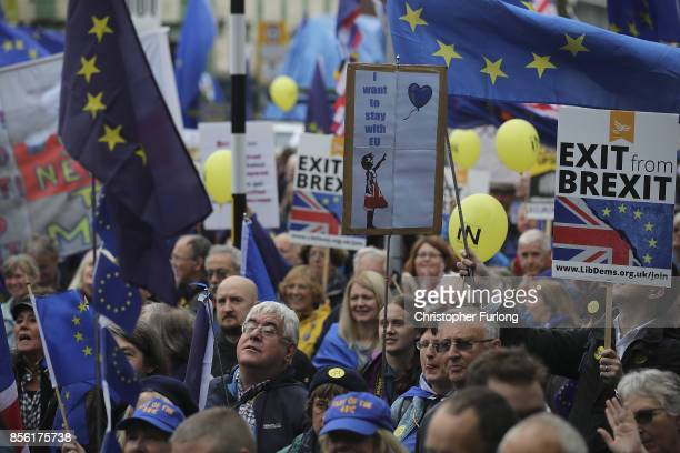 AntiBrexit and antiausterity activists take part in protests as the Conservative party annual conference gets underway at Manchester Central on...