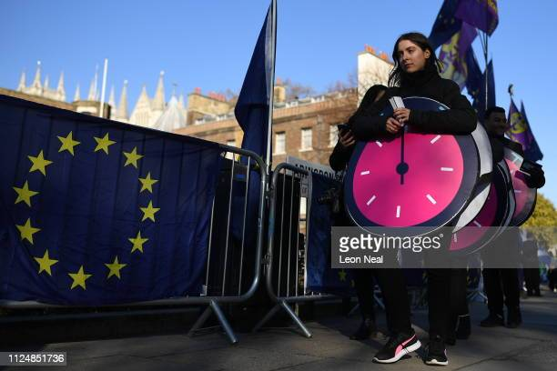 AntiBrexit and probrexit campaigners protest near parliament on February 14 2019 in London England MPs are set to debate and vote on the next steps...