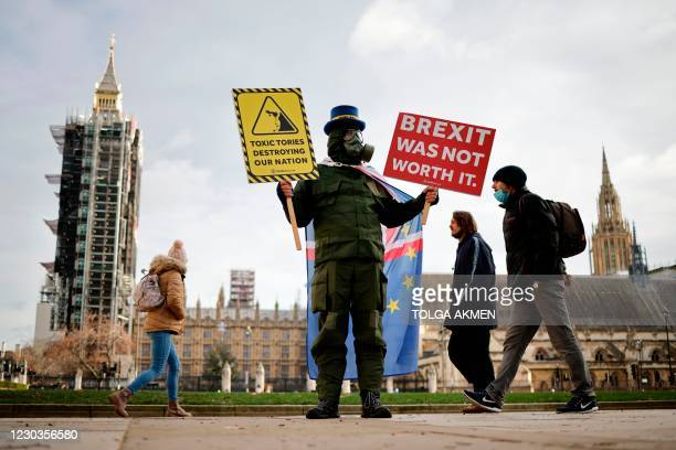 Anti-Brexit campaigner Steve Bray poses with placards in Parliament Square outside the Houses of Parliament in London on December 30 as MPs debate...