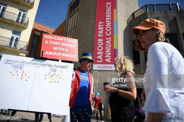 AntiBrexit campaigner Steve Bray speaks with delegates outside the Brighton Centre the venue for this years Labour Party Conference on September 21...