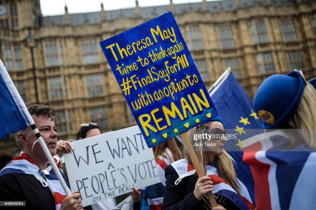 Anti-brexit campaigners demonstrate outside the Houses of Parliament with placards and EU flags as MPs return following the Easter break on April 16, 2018 in London, England. British and European Union officials have begun a new round of Brexit discussions in Brussels today.