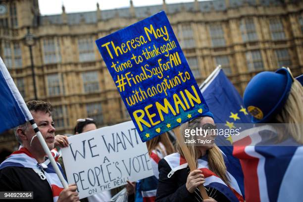 Antibrexit campaigners demonstrate outside the Houses of Parliament with placards and EU flags as MPs return following the Easter break on April 16...