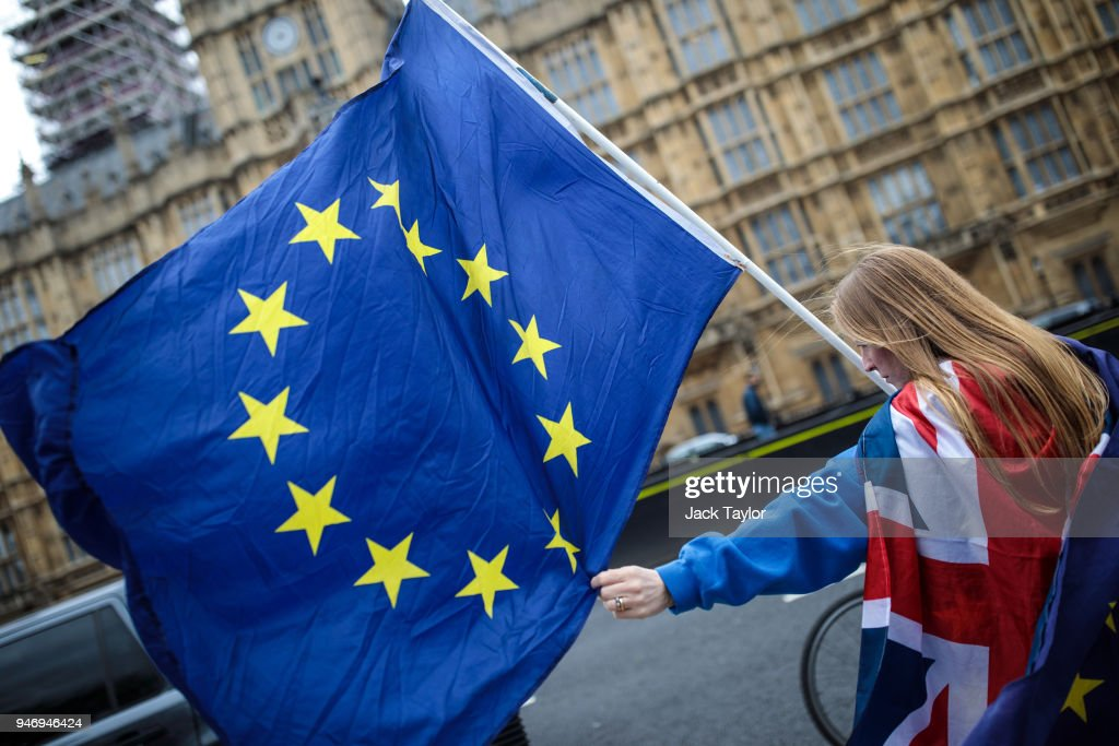 Anti-brexit campaigners demonstrate outside the Houses of Parliament with EU flags as MPs return following the Easter break on April 16, 2018 in London, England. British and European Union officials have begun a new round of Brexit discussions in Brussels today.