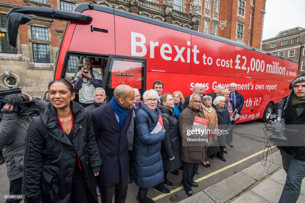 Anti-brexit campaigners including Gina Miller, founding partner of SCM Private LLP, left, and Chuka Umunna, U.K. lawmaker for the opposition Labour party, second left, gather in front of a bus with the campaign motto: 'Brexit to cost £2,000 million a week says government's own report. Is it worth it?' during its inauguration in London, U.K., on Wednesday, Feb. 21, 2018. With talk of a second referendum in the air, opponents of Brexit have decided to take their own red bus on the road. Photographer: Chris J. Ratcliffe/Bloomberg via Getty Images