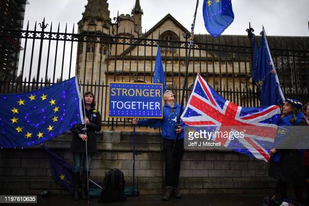 Anti-Brexit campaigners protest outside the Houses of Parliament on January 30, 2020 in London, United Kingdom. At 11.00pm on Friday 31st January the...