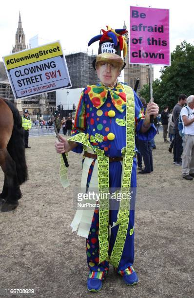 AntiBrexit demonstrator dressed in Boris Johnson's mask and a clown costume protests at Parlament Square London England on Saturday September 7 2019...