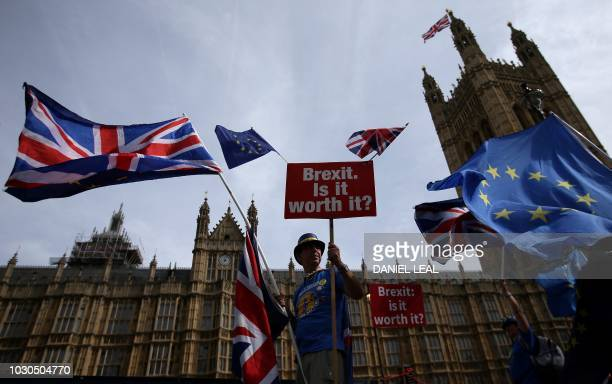 TOPSHOT AntiBrexit demonstrator Steve Bray holds a sign that reads 'Brexit Is it worth it' whilst draped in European Union and Union flags as he...