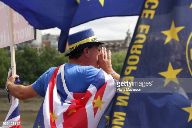 AntiBrexit demonstrators gather on Westminster Bridge outside the Houses of Parliament on June 20 2018 in London England MPs will consider the...