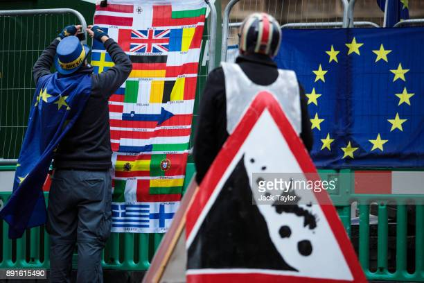 Antibrexit demonstrators gather with European Union flags outside the Houses of Parliament on December 13 2017 in London England MPs are debating and...