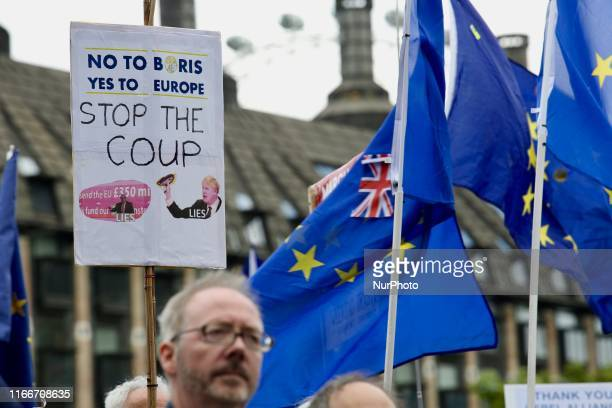 AntiBrexit demonstrators hold EU and British flags and a 'Stop the Coup' sign at Parlament Square London England on Saturday September 7 2019 The...