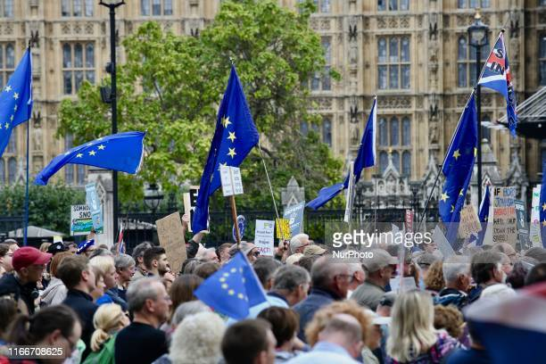 AntiBrexit demonstrators hold EU and British flags at Parlament Square London England on Saturday September 7 2019 The protests took place amid...