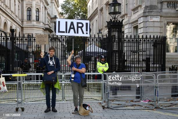 AntiBrexit demonstrators hold 'Liar' banner in front of Downing Street London England on Saturday September 7 2019 The protests took place amid...