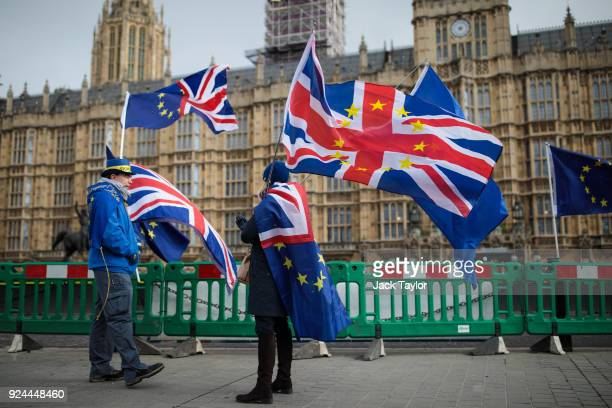 AntiBrexit demonstrators protest with flags outside the Houses of Common on February 26 2018 in London England Labour Leader Jeremy Corbyn's Brexit...