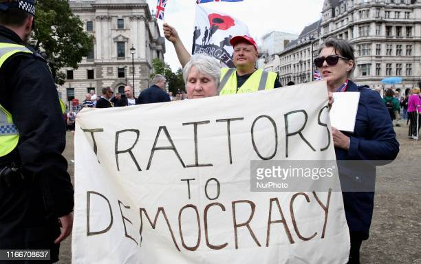 AntiBrexit demonstrators secured by a number of police officers protest at Parlament Square London England on Saturday September 7 2019 The protests...