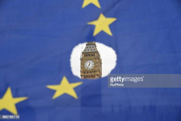 AntiBrexit demonstrators show EU flags outside Downing Street and the Houses of Parliament London on March 29 2017 The Government has triggered...