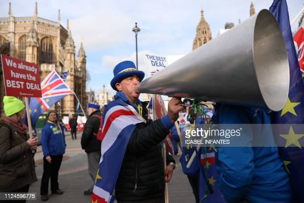 TOPSHOT AntiBrexit proEU demonstrator Steve Bray shouts into a megaphone as he joins demonstrators outside the Houses of Parliament in London on...