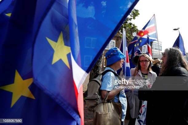 AntiBrexit proEuropean Union supporters carry placards and EU and Union flags as they wait outside Dover Town Hall in Dover southeast England on...