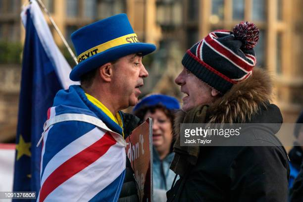 AntiBrexit protester Steve Bray and a proBrexit protester argue as they demonstrate outside the Houses of Parliament in Westminster on January 08...