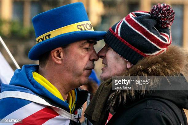 Anti-Brexit protester Steve Bray and a pro-Brexit protester argue as they demonstrate outside the Houses of Parliament in Westminster on January 08,...
