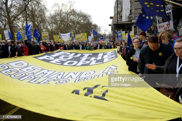 AntiBrexit protesters are seen holding a banner placards and EU flags during the demonstration Over a million people marched peacefully in central...