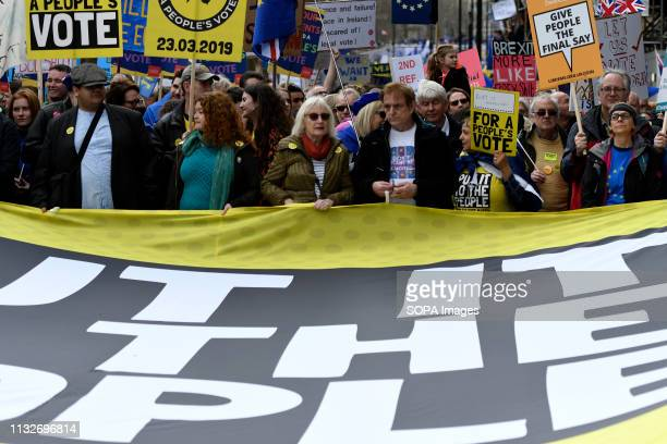 AntiBrexit protesters are seen holding a banner placards during the demonstration Over a million people marched peacefully in central London in favor...