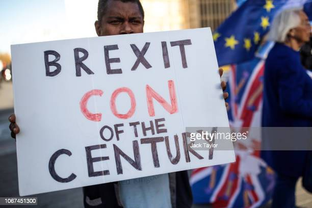AntiBrexit protesters demonstrate in Westminster on November 14 2018 in London England Theresa May will today attempt to secure the backing of her...