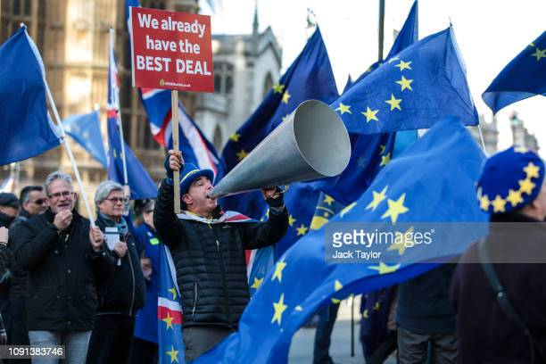 AntiBrexit protesters demonstrate outside the Houses of Parliament in Westminster on January 08 2019 in London England MPs in Parliament are to vote...