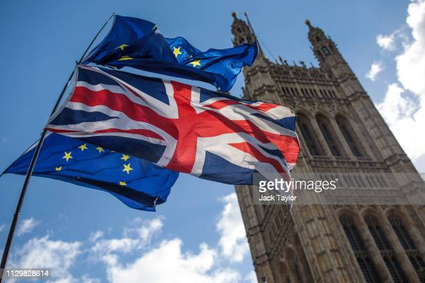 Anti-Brexit protesters demonstrate with flags outside the House of Parliament on March 11, 2019 in London, England. Talks between the UK and the EU...