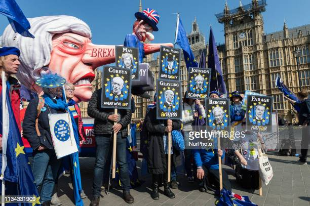 AntiBrexit protesters hold placards depicting Chris Grayling Jacob ReesMogg Theresa May Jeremy Corbyn John Bercow Boris Johnson and Nigel Farage next...