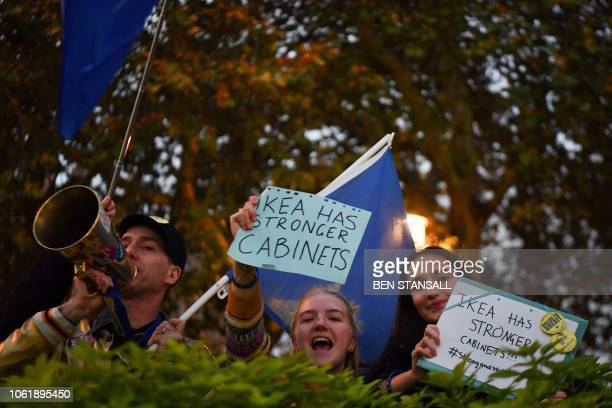 AntiBrexit protesters shout slogans with placards and EU flags near the Houses of Parliament in central London on November 15 2018 British Prime...