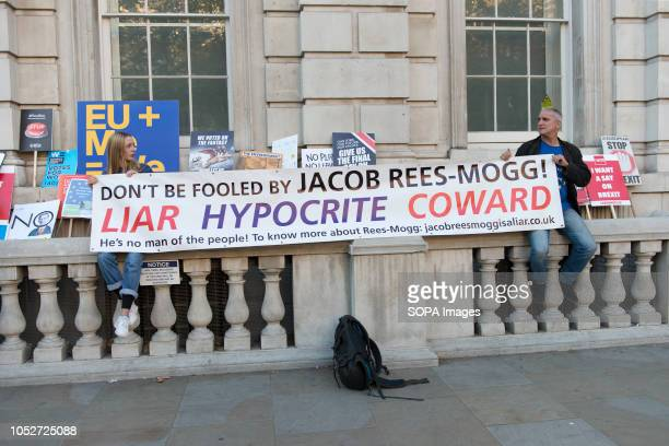 AntiBrexit protesters sitting on the balcony holding a banner during a huge demonstration organised by the People's vote campaign The rally gathered...
