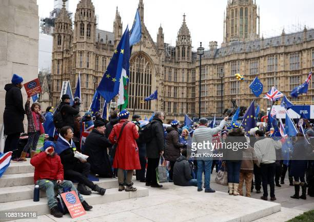 AntiBrexit protesters wave EU flags as they protest on the day that MPs vote on Theresa May's Brexit deal outside the House of Commons on January 15...