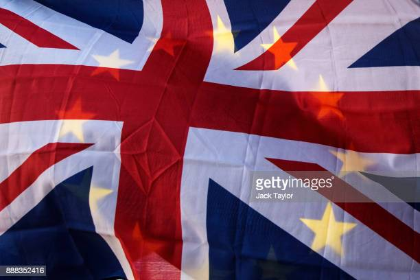 Antibrexit protesters wave the Union Jack and the EU flag outside the Houses of Parliament on December 8 2017 in London England British Prime...
