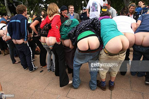 AntiBush activists bare their buttocks for the international media at the 'Bums For Bush' protest during the AsiaPacific Economic Cooperation...