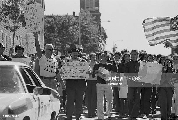 Antibusing demonstrators some dressed in colonial costume march down Bunker Hill Street in Boston's Charlestown section 9/30 A white boycott of...