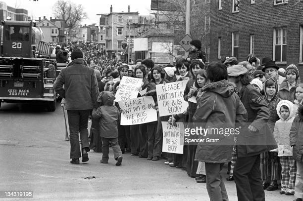 Antibusing protestors line a street to demonstrate against forced busing of students into formerly allwhite South Boston schools September 1974