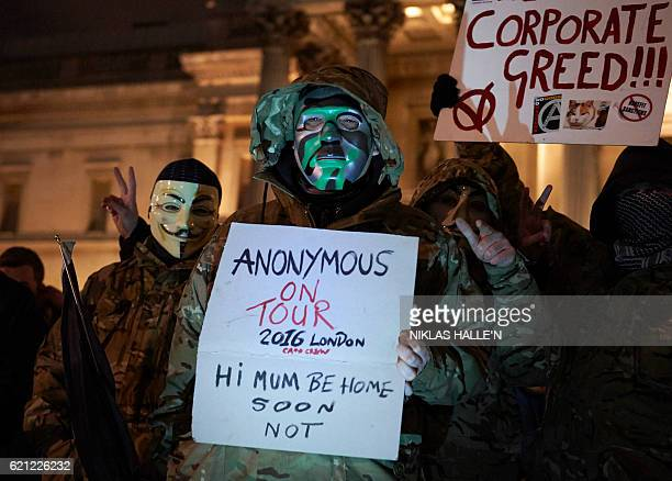 Anticapitalist activists wearing masks gather ahead of the 'Million Masks March' organised by the group Anonymous at Trafalgar Square in London on...