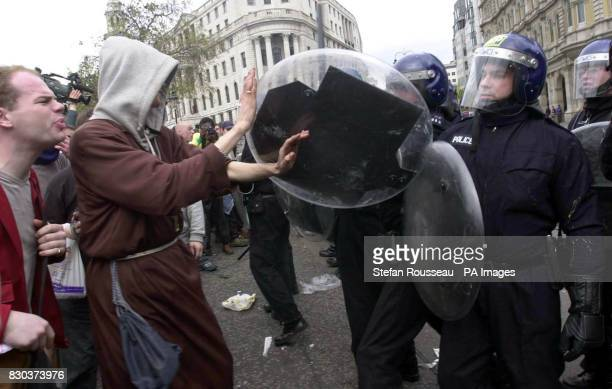 Anticapitalist demonstrators taunt riot police in Trafalgar Square during their May Day march from Parliament Square Violence erupted as police...