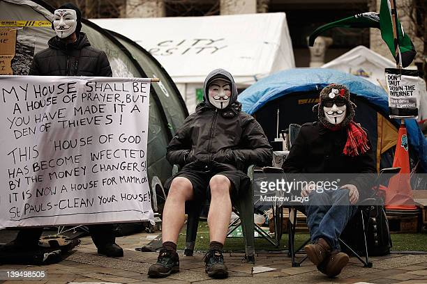 AntiCapitalist protestors from the Occupy LSX movement at St Paul's Cathedral pose for photographers on February 22 2012 in London England Set up...