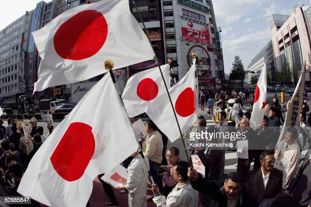AntiChina protesters from Taiwan and Tibet living in Japan and rightish Japanese shout slogans and carry the Japanese flag during a demonstration in...