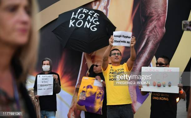 AntiChinese Communist Party activists protest outside Staples Center where free tshirts were distributed supporting Hong Kong ahead of the Lakers vs...