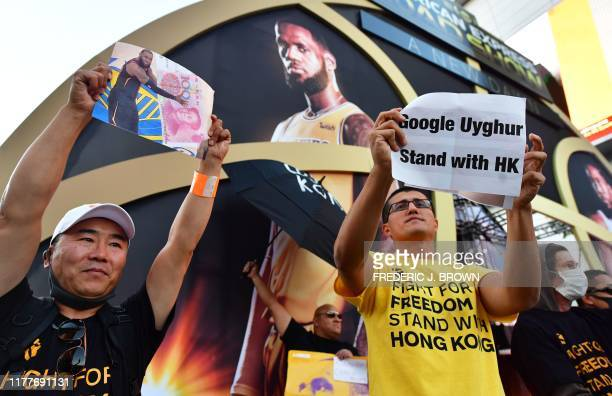 AntiChinese Communist Party activists protest outside Staples Center ahead of the Lakers vs Clippers NBA season opener in Los Angeles on October 22...