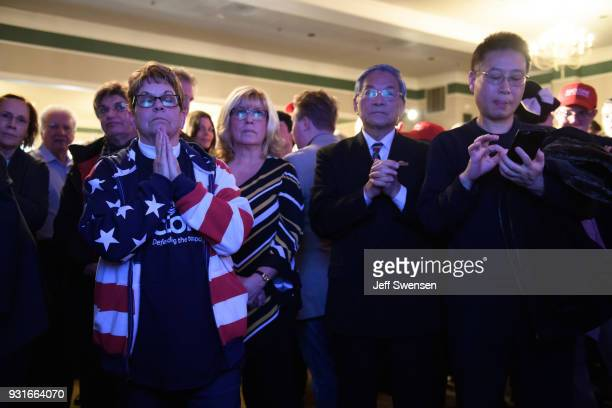 Anticipation builds among as they watch early election results at an Election Night event for GOP PA Congressional Candidate Rick Saccone as the...