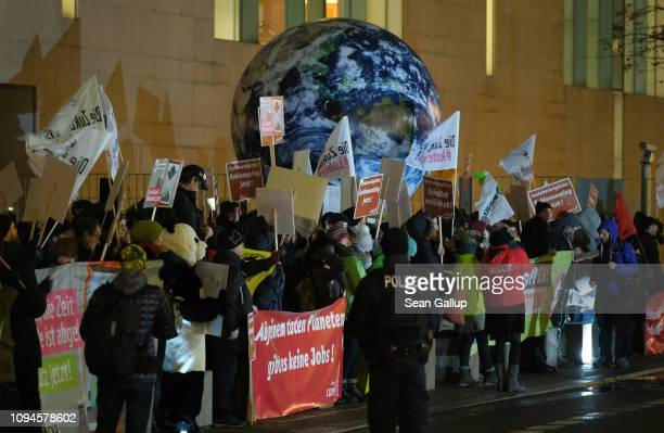 Anticoal activists demonstrate outside the Chancellery prior to a meeting between Merkel and the Federal Coal Commission on January 15 2019 in Berlin...