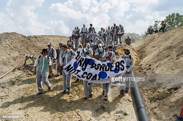 Anticoal activists march to a loading station by the Welzow Sued openpit coal mine on May 13 2016 near Spremberg Germany The activists part of a...