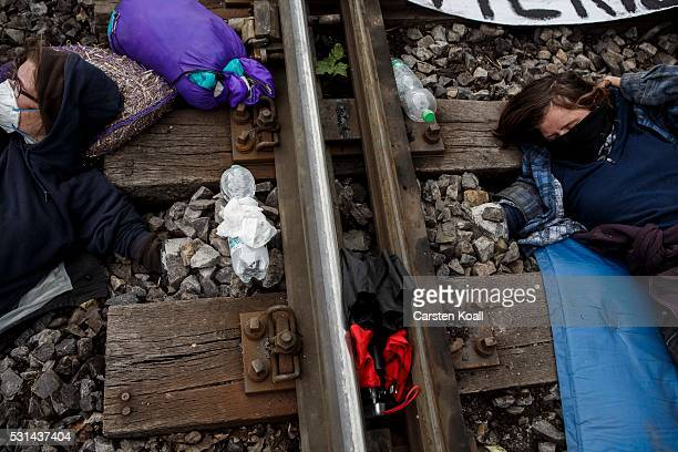 Anticoal mine activists have under the railroad track chained during a railway blockade in direction of the coal mine company Vattenfall factory...