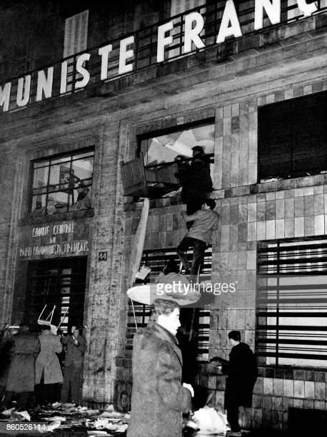 Anticommunist demonstrators wreck the Central Committee of French Communist Party headquarters on November 8 1956 in the Chateaudun street of Paris...