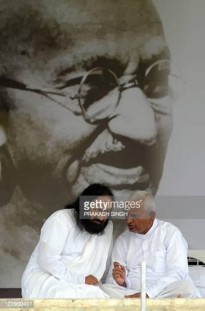 Anticorruption activist Anna Hazare and spiritual leader Sri Sri Ravi Shankar speak at Ramlila Grounds in New Delhi on August 22 2011 Responding to...